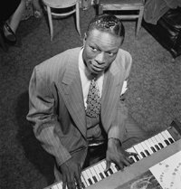 "Nat ""King"" Cole at the piano"
