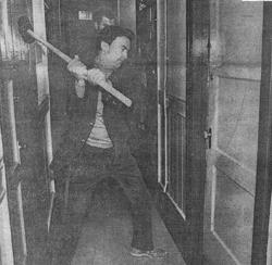 Sheriff Richard Hongisto wielding a sledge hammer at International Hotel eviction