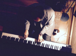 Me playing Frank Lloyd Wright's piano at Christmas time.