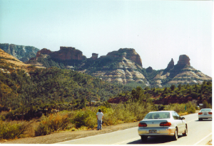 Bryan asked us to stop so many times on our first trip to Sedona. Here he checks out formations just across from Midgely Bridge.
