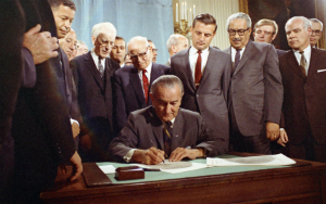 LBJ signs the Fair Housing Act, 1968