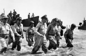 """""""Carlos, my boy! How does it feel to be home?"""" MacArthur to Romulo, October 20, 1944."""